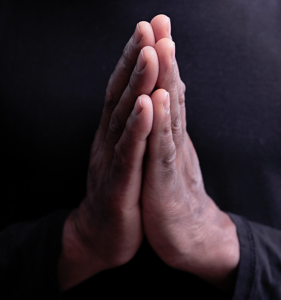 Picture of a person's hands clasped together